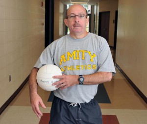 Photo by Peter Casolino/Register Paul Thees is back as the head coach of the Amity volleyball team. Thees coached Amity for 16 seasons before resigning in 2007.